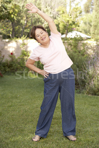 Senior Woman Exercising In Garden Stock photo © monkey_business