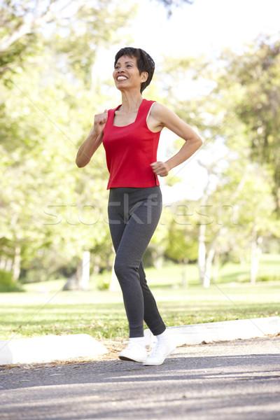 Stockfoto: Senior · vrouw · jogging · park · gelukkig · lopen