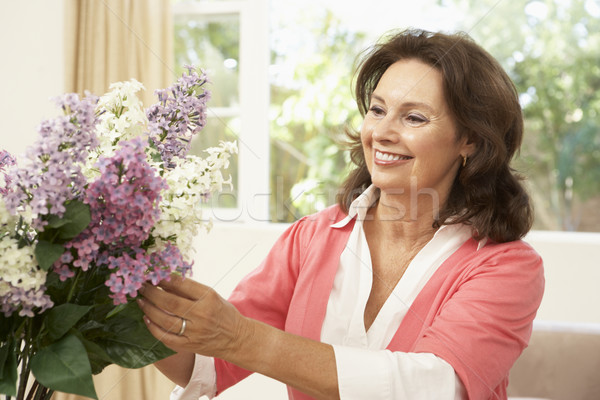 Senior Woman At Home Arranging Flowers Stock photo © monkey_business