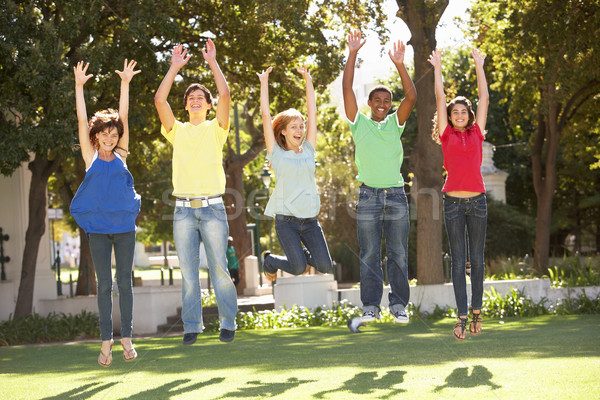Group Of Teenagers Jumping In Air In Park Stock photo © monkey_business