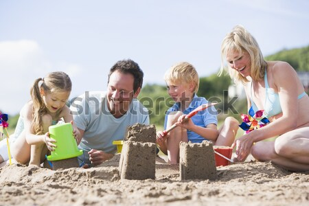 Famille bâtiment sandcastle hiver plage fille Photo stock © monkey_business