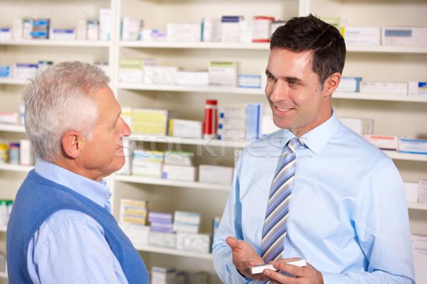 UK pharmacist serving  senior man in pharmacy Stock photo © monkey_business