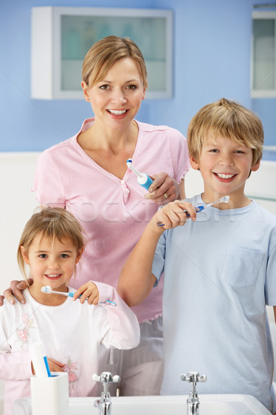 Mother and children cleaning teeth in bathroom Stock photo © monkey_business