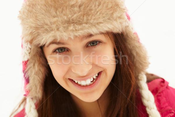Portrait Of Teenage Girl In Snow Wearing Fur Hat Stock photo © monkey_business
