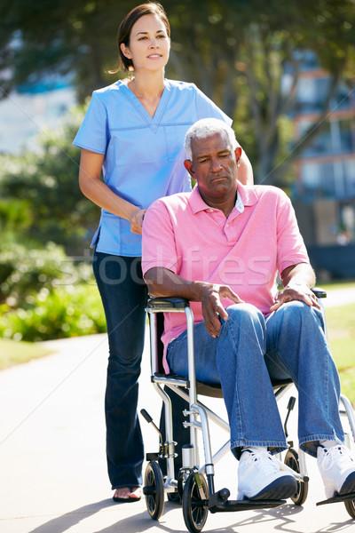 Gondozó toló boldogtalan idős férfi tolószék Stock fotó © monkey_business