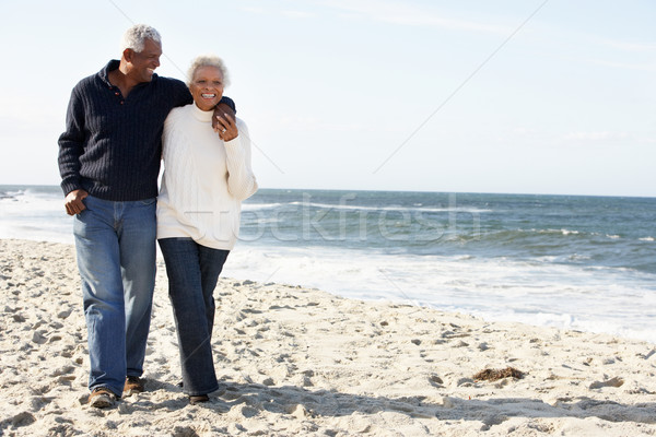 Senior Couple Walking Along Beach Together Stock photo © monkey_business