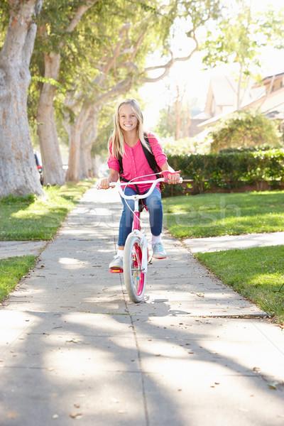 Girl Wearing Rucksack Cycling To School Stock photo © monkey_business