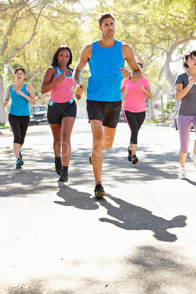 Group Of Women Running Along Street With Personal Trainer Stock photo © monkey_business