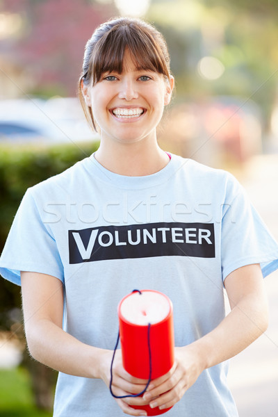 Portrait Of Charity Volunteer On Street With Collection Tin Stock photo © monkey_business