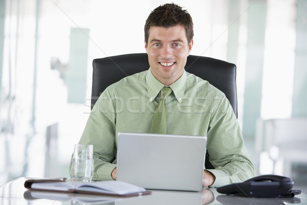 Businessman sitting in office with personal organizer using lapt Stock photo © monkey_business