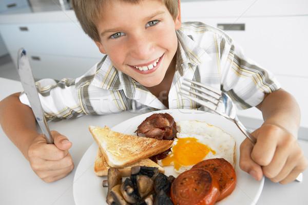 Młody chłopak jedzenie niezdrowy śniadanie żywności Zdjęcia stock © monkey_business