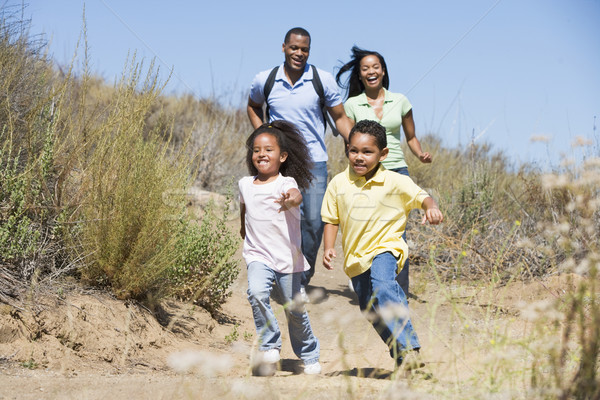 Family running on path smiling Stock photo © monkey_business