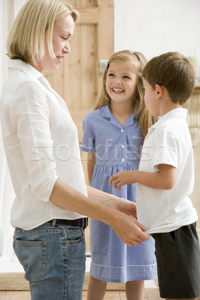 Woman in front hallway with two young children smiling Stock photo © monkey_business