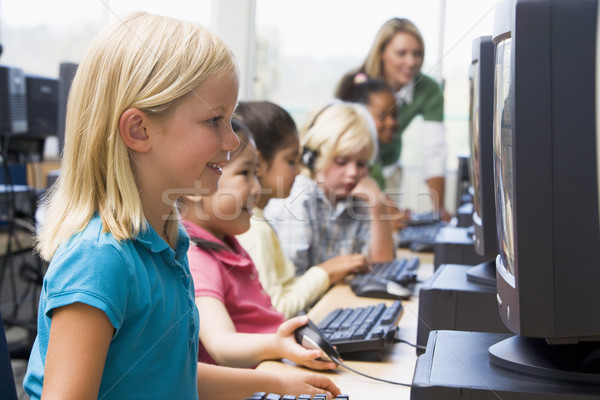 Kindergarten children learning how to use computers. Stock photo © monkey_business