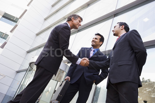 Stock photo: Business people shaking hands outside office