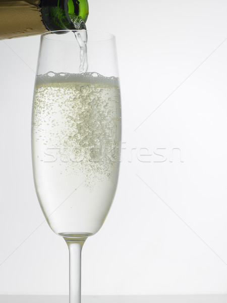 Champagne Pouring Into Flute Stock photo © monkey_business