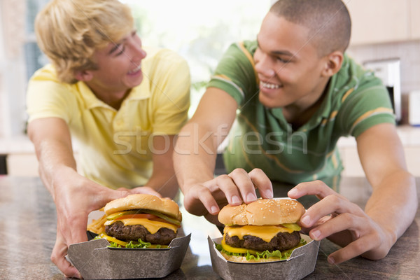 Adolescentes comer casa diversión adolescente adolescentes Foto stock © monkey_business