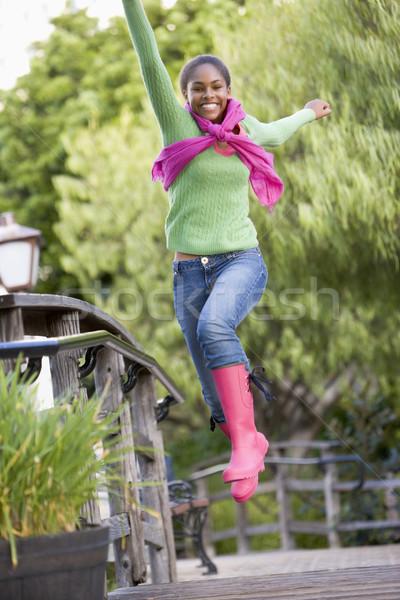 Teenage Girl Frolicking Outdoors Stock photo © monkey_business