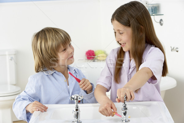 Siblings Brushing Teeth Together at Sink Stock photo © monkey_business