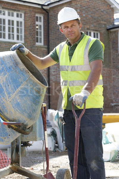 Construction Worker Mixing Cement Stock photo © monkey_business