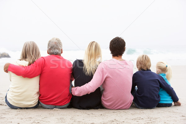 Back View Of Three Generation Family Sitting On Winter Beach Tog Stock photo © monkey_business
