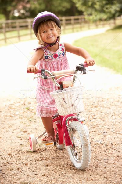 Kız öğrenme bisiklet kask çocuk Stok fotoğraf © monkey_business
