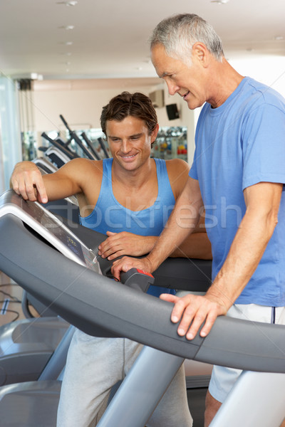 Man Working With Personal Trainer On Running Machine In Gym Stock photo © monkey_business