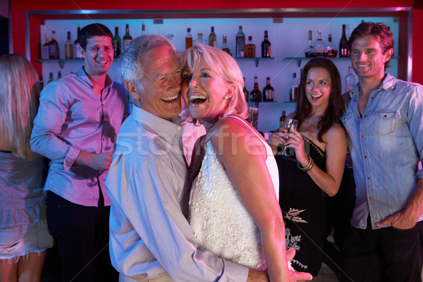 Senior Couple Having Fun In Busy Bar Stock photo © monkey_business