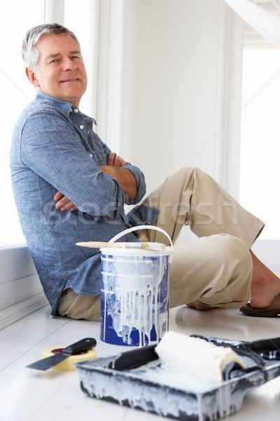 Senior man decorating house Stock photo © monkey_business