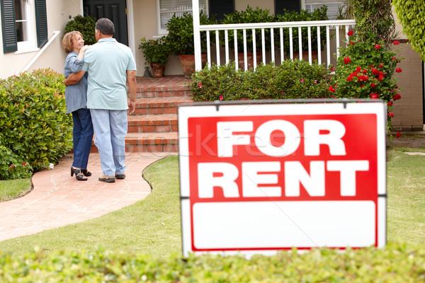 Senior Hispanic couple renting new home Stock photo © monkey_business