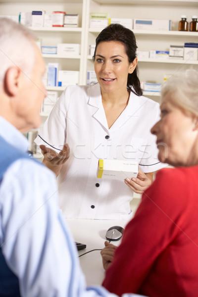 American pharmacist dispensing to senior couple Stock photo © monkey_business