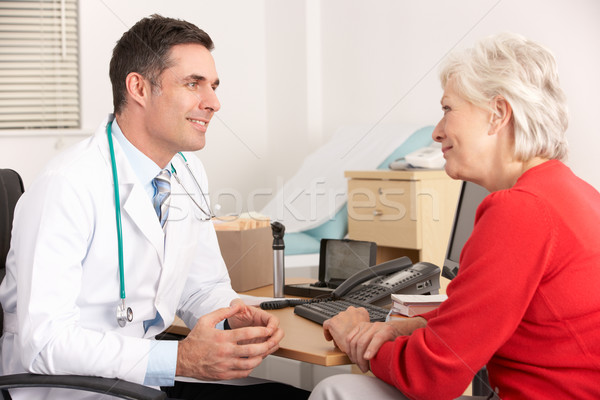 American doctor talking to senior woman in surgery Stock photo © monkey_business