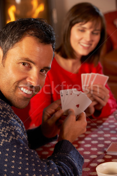 Couple Playing Cards By Cosy Log Fire Stock photo © monkey_business