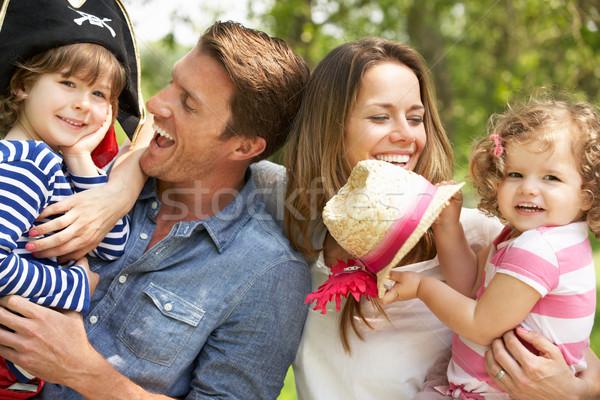 Pais jogar emocionante aventura jogo crianças Foto stock © monkey_business