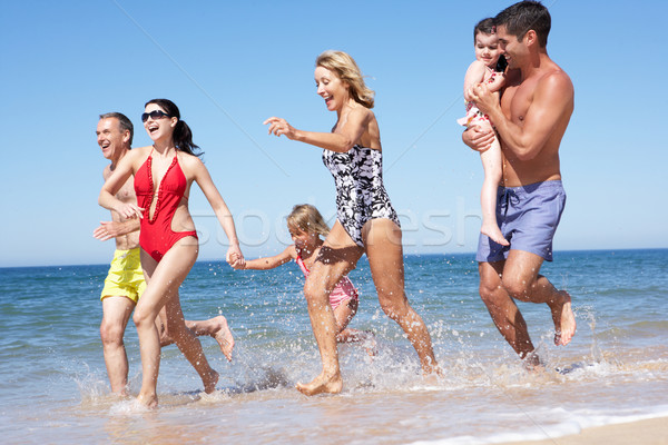 Stock photo: Multi Generation Family Enjoying Beach Holiday