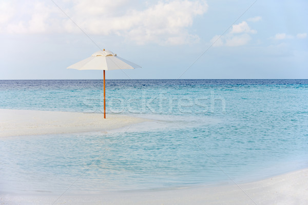 Beautiful Deserted Beach With Parasol Stock photo © monkey_business