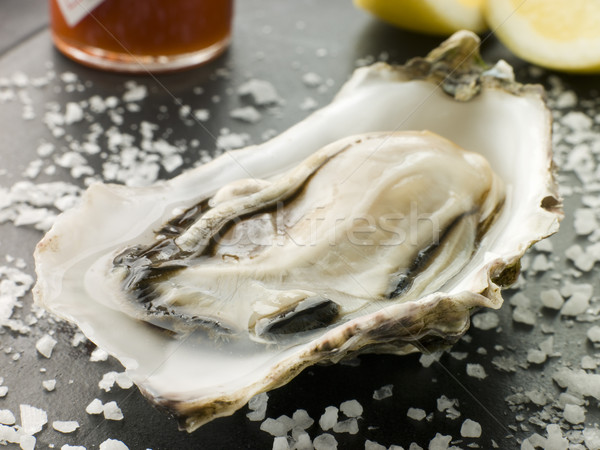 Opened Rock Oyster with Hot Chilli Sauce Lemon and Sea Salt Stock photo © monkey_business