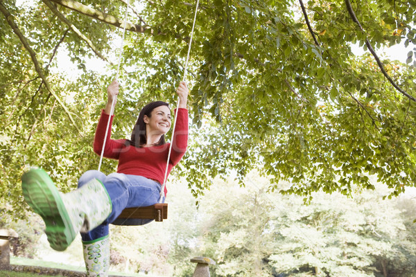 Young woman on swing Stock photo © monkey_business