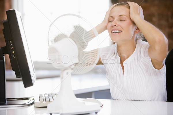 Businesswoman in office with computer and fan cooling off Stock photo © monkey_business