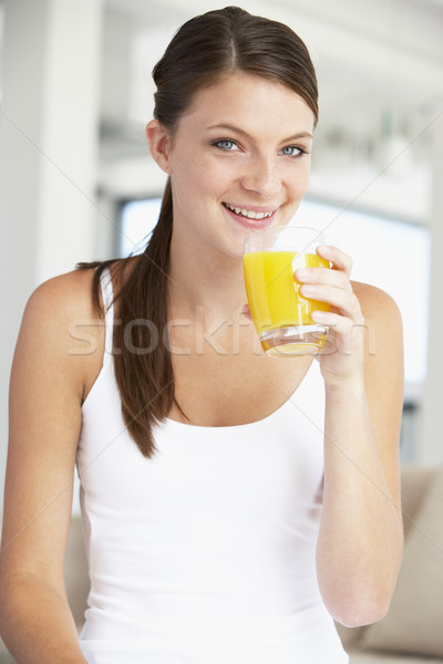 Genç kadın portakal suyu kadın ev cam Stok fotoğraf © monkey_business