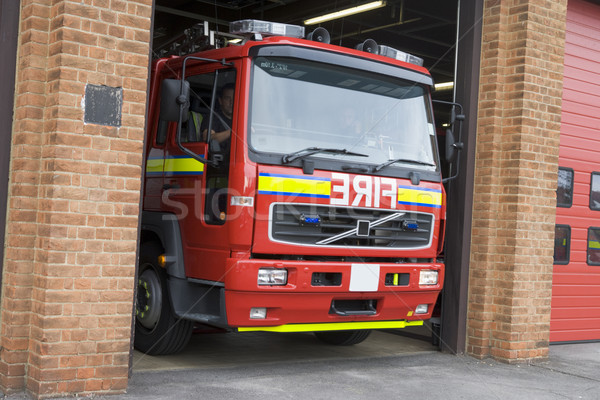 A fire engine leaving the fire station Stock photo © monkey_business