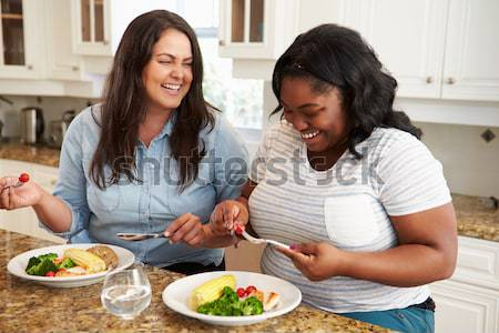 Couple repas ensemble femme Photo stock © monkey_business