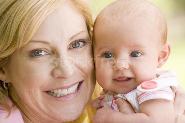 Anya baba kint mosolyog szeretet boldog Stock fotó © monkey_business