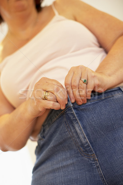 Overweight Woman Trying To Fasten Trousers Stock photo © monkey_business