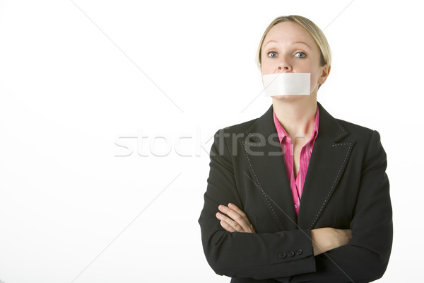 Businesswoman With Her Arms Folded And Mouth Taped Shut Stock photo © monkey_business