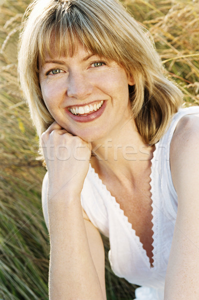 Woman sitting outdoors smiling Stock photo © monkey_business