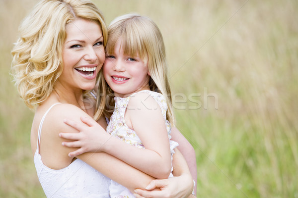 Madre hija aire libre sonriendo nino Foto stock © monkey_business
