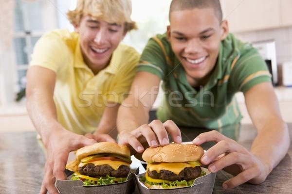 Ragazzi adolescenti mangiare home divertimento adolescenti sorridere Foto d'archivio © monkey_business