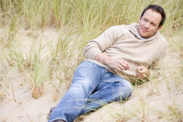 Man sitting back on beach Stock photo © monkey_business