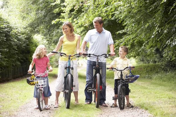 Сток-фото: семьи · верховая · езда · велосипедах · улыбка · человека